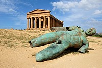 Agrigento  Sicily  Italy  Temple of Concordia &amp; Fallen Ikarus sculpture by Igor Mitoraj, Valley of the Temples archaeological site