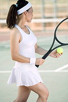 Woman Tennis Player Serving Ball