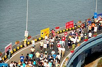 Participants running on Charni road flyover at the Queen´s Necklace in Nariman Point , Mumbai marathon event organized in Bombay now Mumbai , Maharash...