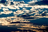 Silver clouds on dark blue sky