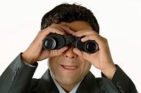 Office going man looking through binocular MR748L