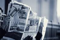 Newspaper Readers in a Park