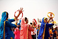 Young Sikh girls doing Giddha folk dance during cultural events held for celebrations of 300th year of consecration of perpetual Guru Granth Sahib ; N...