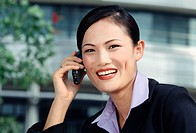 Happy Businesswoman on Cell Phone