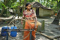 Keralite woman making coir rope in cottage , traditional method , Kerala , India NO MR