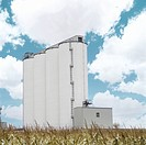 Low angle view of grain elevators in rural setting