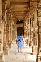 Handicapped lady walking in gallery in Qutab Minar campus , Delhi , India
