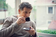 Portrait of a man drinking an espresso