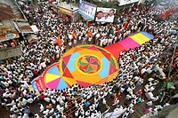 Grand colourful flower Rangoli made on road for immersion celebration of Lord Ganesh , Sangli , Maharashtra , India