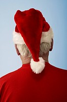 Portrait of an aging man wearing a Santa Claus hat