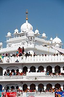 Devotees watching procession of Hola Mohalla festival from Anandpur sahib Gurudwara in Rupnagar district , Punjab , India