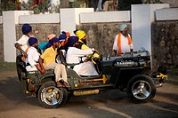 Group of Nihangs or Sikh warriors driving jeep during Hola Mahalla celebration at Anandpur sahib in Rupnagar district , Punjab , India