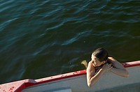 Young Woman Clinging to the Side of a Boat