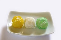 Mithai , colourful nariyal ka laddoos in rectangle plate on white background
