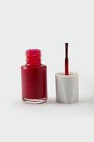 Bottle of Nail Polish and Brush