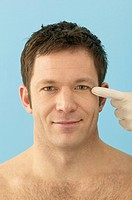 Plastic Surgeon Pointing at Man´s Face
