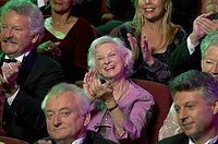 Woman Laughing and Applauding at the Theater