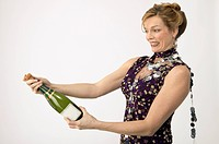 Woman Uncorking Champagne Bottle