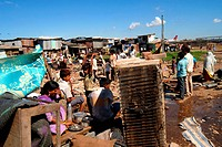 Slum dwellers sit with their belongings after demolition of slums on Sahar airport Chatrapati Shivaji International airport in Bombay Mumbai , Maharas...