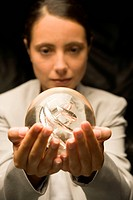 Businesswoman staring at a crystal ball
