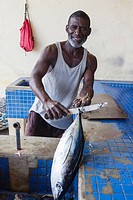 Local fishermen gutting a tuna at the fish market, Micoud, st Lucia