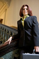 Businesswoman Standing on Staircase