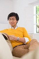 Young Asian man studying a foreign language book