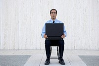 Solitary Businessman with an Open Briefcase