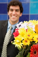Smiling Man with Flower Bouquet