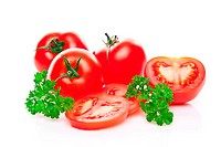 Tomatoes with parsley isolated on white