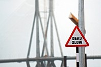 Dead slow signboard on bandra worli known rajiv gandhi sea link ; Bombay Mumbai ; Maharashtra ; India 30-June-2009