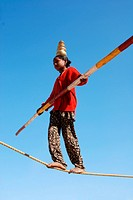 Girl performing acrobat on rope ; Jaisalmer ; Rajasthan ; India NOMR