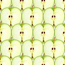 Seamless pattern with slices of green apple