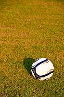 Soccer ball or football ball on green field