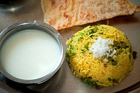 Food , vegetarian thali with pulao and buttermilk
