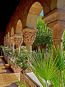 Summer plants fill the Cuxa Cloister at The Cloisters in Fort Tryon Park, Washington Heights, New York City  The building, which is a branch of the Me...
