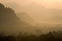 Silhouette of hills in foggy landscape