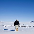 Man walking in snowy landscape