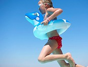 Girl jumping in inflatable ring
