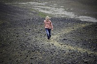 Girl walking in rocky landscape