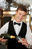 Waiter pouring champagne into champagne flute