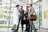 Doctor and businessmen talking
