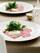 Plate of carpaccio with salad