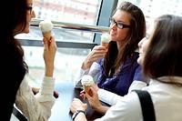 happy women licking ice cream