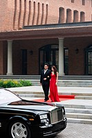 Young couple with limousine