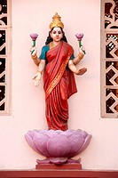 Goddess lakshmi idol standing in lotus on temple , Mangalore , Karnataka , India 2010