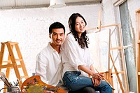 A female and male artist having rest in studio