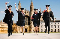 University students in gown jumping