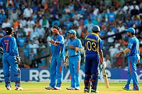 Indian player CYuvraj Singh, Suresh Raina talk to captain M S Dhoni for third umpire appeal while Sri Lanka batsman Samaraweera Indian player Virat Ko...