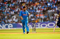 Indian player Sachin Tendulkar reacts during his bowling spell in the ICC Cricket World Cup finals against Sri Lanka played at the Wankhede stadium in...
